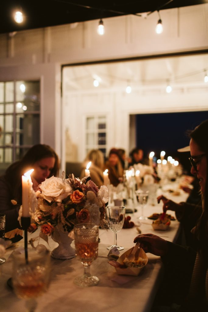 girls night eating dinner by candlelight