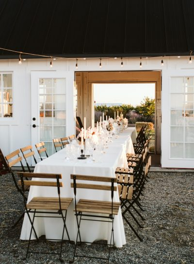 white farmhouse with long table running though building