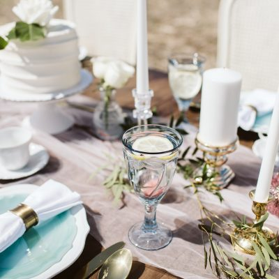 Outdoor wedding table setting in field