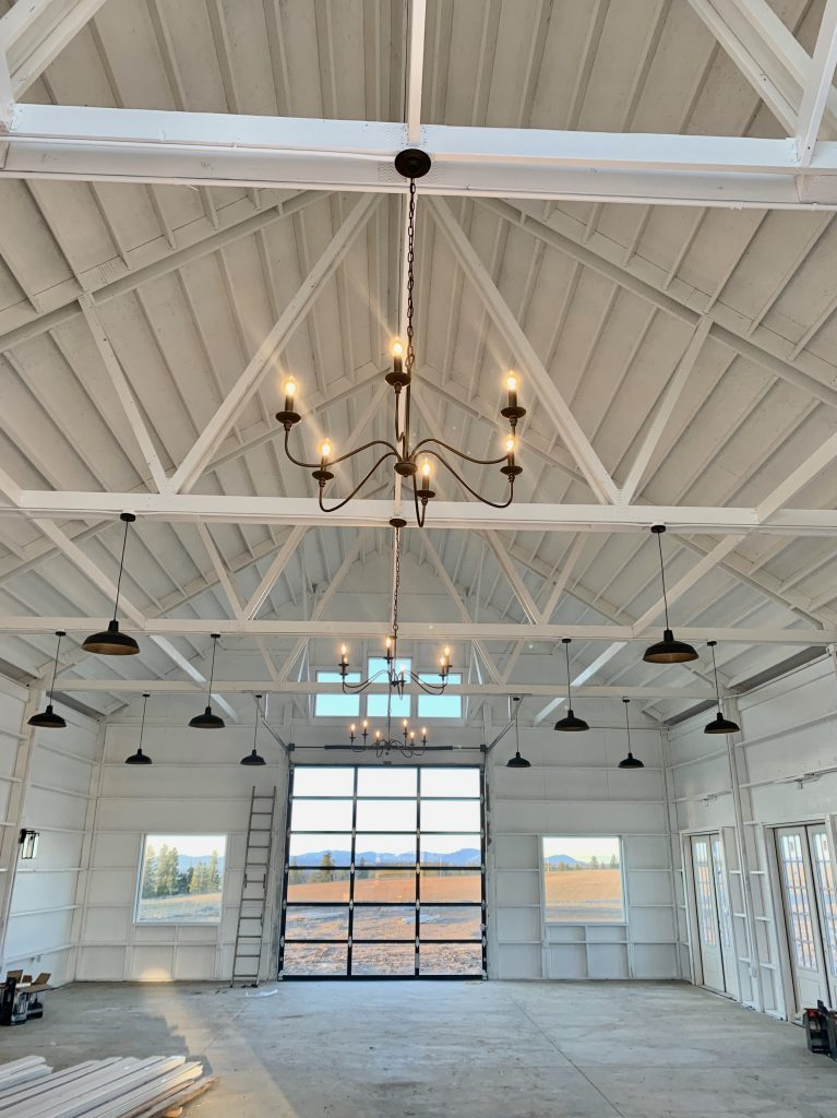 white barn interior chandelier and barn lights hanging