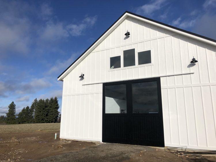 white barn with black barn doors